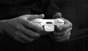 Two hands holding a video game controller