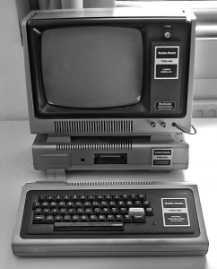 TRS-80 Model III, the first personal computer I ever laid my eyes (and hands) on.
